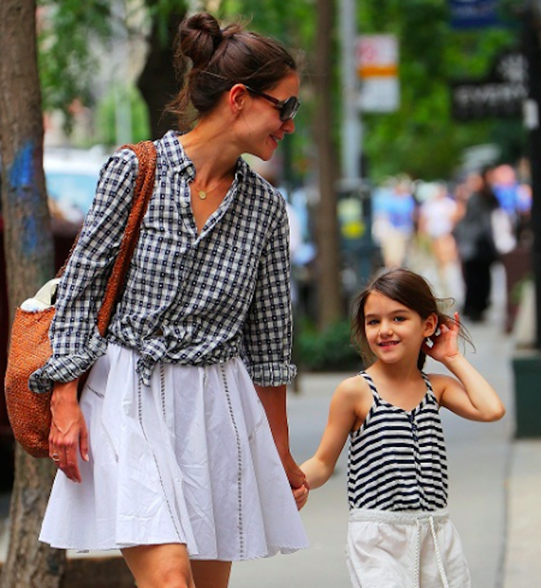 Katie and Suri cruising down the street